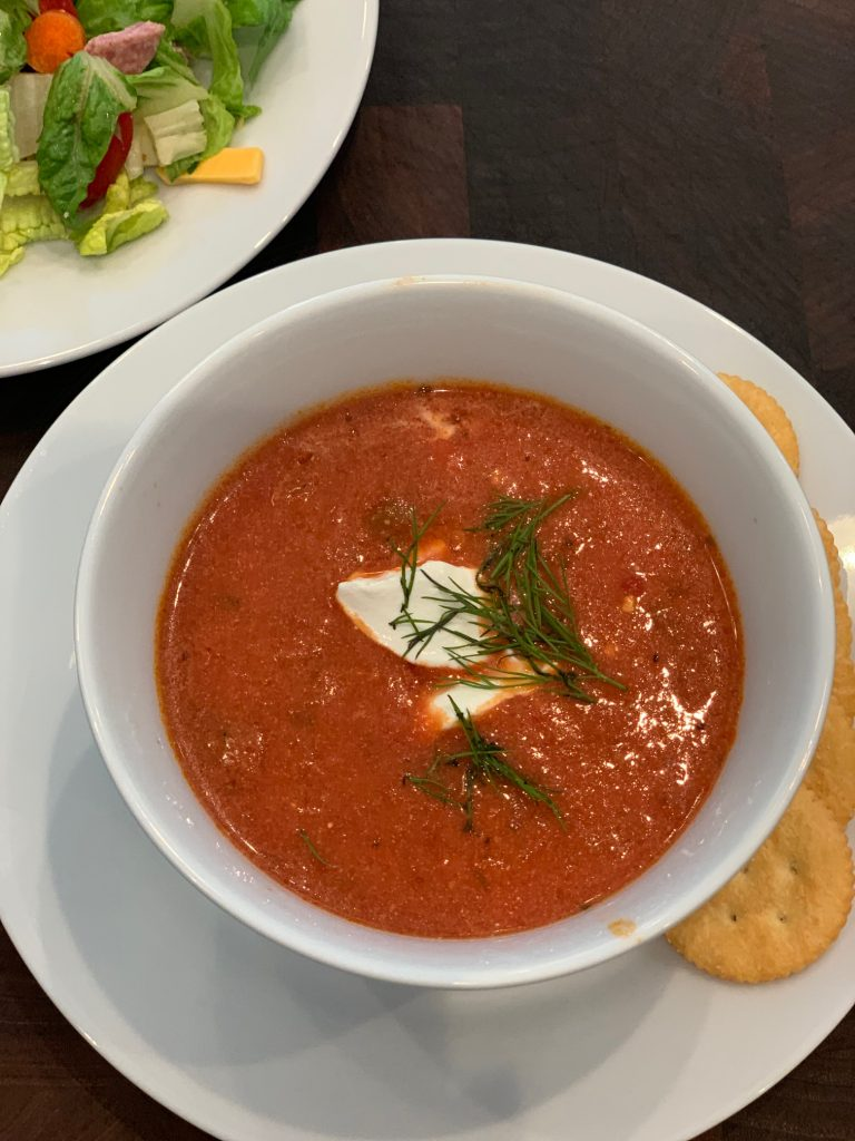 Tomato Soup in Bowl with Crackers