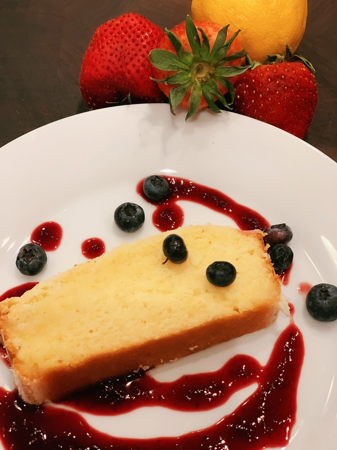 glazed lemon cake with berry sauce